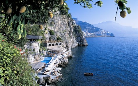 An insider's guide to the best hotels on the Amalfi Coast, featuring the top places to stay for clifftop views, romantic dining, Michelin-starred restaurants, private terraces and delightful breakfasts, in locations including Positano, Sorrento and Ravello