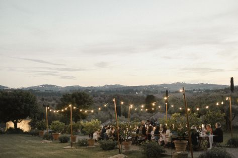When it comes to DIY wedding decorations, bistro lights are as good as it gets. Hang a few strands along the perimeter of your wedding venue to brighten and personalize the space in a matter of minutes. Infuse the cables with garlands and leaves for extra flair. Click through for more DIY wedding decorations! #diyweddingdecorations #diyweddingdecor #diywedding #weddingdecorideas #bistrolights