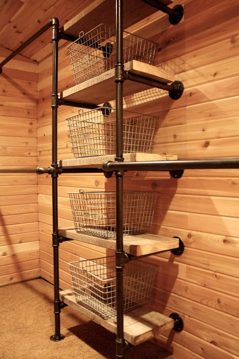 Industrial Pipe Closet System - using salvaged boards for the shelves and vintage wire locker baskets to hold the small things. The closet walls and ceiling were lined with cedar. To remodel front closet, pantry, master closet Industrial Closet, Industrial House, Industrial Furniture, Vintage Industrial, Decor Industrial, Industrial Pipe Shelves, Plumbing Pipe Shelves, Industrial Decorating, Black Pipe Shelving