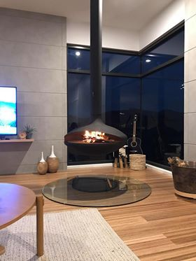 Wood Burning Suspended Fireplace With Glass Floor Protector