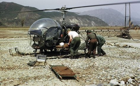 A helicopter delivers a wounded soldier from the front lines to the MASH unit, stationed 10 miles away, during the Korean war.