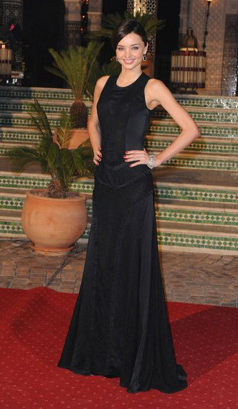 Miranda Kerr Evening Dress Miranda Kerr looked all too elegant in a black evening gown. she pulled her hair up in a sleek bun to complete her look.