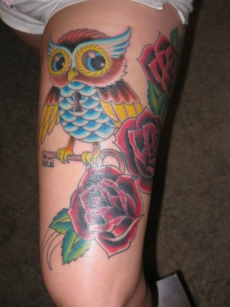 new traditional owl tattoo. Leg tattoo with roses on upper thigh.