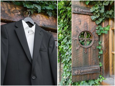 Groom black suit hanging on barn door at Wadley Farms | Wadley Farms Summer Wedding | Jessie and Dallin Photography #wadleyfarms #utahwedding #utahsummerwedding #utahbride #utahweddings #utahvalleybride #summerwedding #groom #groomstyle