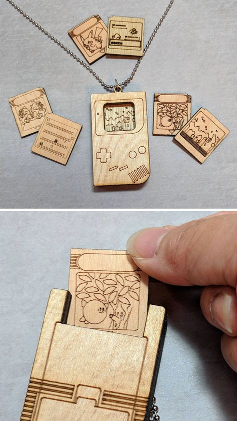 This wood burned Game Boy pendant comes with three double sided and changeable game cartridges! Insert the game cartridge like you would on a real Game Boy and view it in the gaming window. Minecraft Banner Designs, Minecraft Banners, Game Boy, Geek Crafts, Diy And Crafts, Bijou Geek, Video Game Crafts, Video Games, Video Game Art