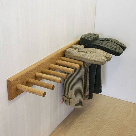 oak welly rack by a+b furniture | notonthehighstreet.com. But could make this easily and put it in the wash house.