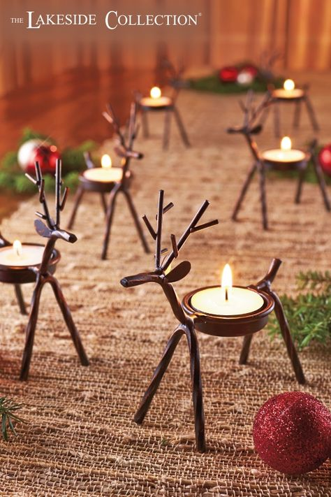 Add the soft glow of candlelight to your entryway or dining table with this Set of 6 Reindeer Tea Light Holders. Each metal reindeer has a spot on its back to hold a tea light or LED tea light candle. Keep your little herd together or split them up around the house. Perfect Christmas decor for your home.