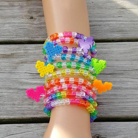 These kandi bracelets are made with rainbow pony beads and perler beads. Rave Bracelets, Pony Bead Bracelets, Candy Bracelet, Kids Bracelets, Pony Beads, Rainbow Loom Bracelets, Pony Bead Jewelry, Candy Jewelry, Cute Jewelry