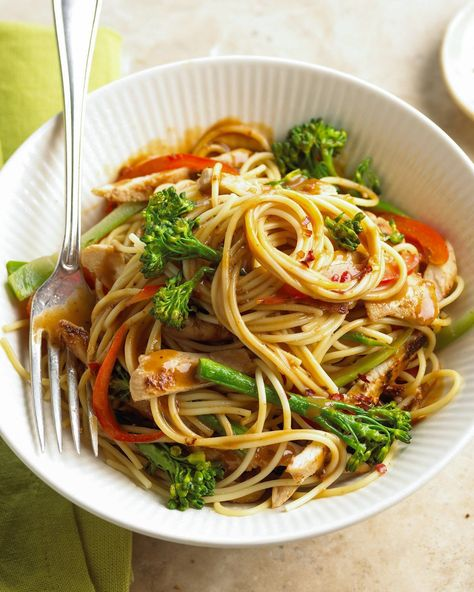 Broccolini and red bell peppers add freshness, chicken breasts crank up the protein, and bottled peanut sauce infuses each bite with a pleasant nutty quality. #pastarecipe #quickdinner #easymeals #dinnerideas #quickandeasyrecipe #bhg