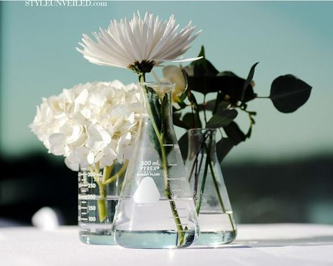 Wedding centerpiece idea: Beakers as vases...bringing some science to the wedding (: