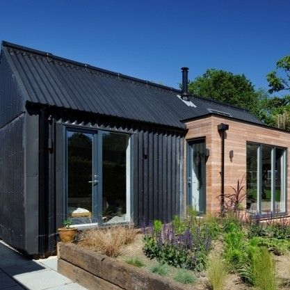 Emerging Architects Pad Studio Specified The Marley Eternit Profile 6 In Black For The Roof And Facade House Cladding Wood Cladding Exterior Cottage Extension