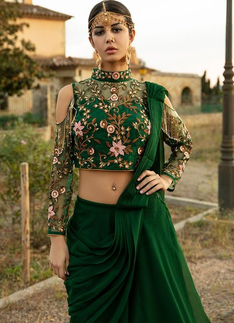 Emerald Green Lehenga Style Saree features a net blouse with santoon inner alongside a georgette saree with santoon inner. Embroidery work on this style is completed with zari, thread, handwork and stone embellishments.