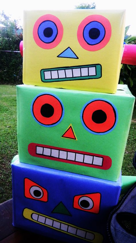 DIY: Robot Heads  What I used:  - cereal boxes  - scotch tape  - glue  - construction paper (any color)  - black sharpie