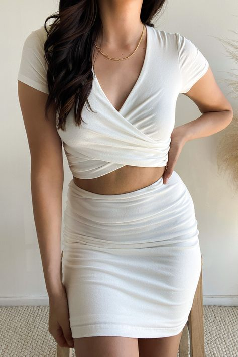 Lulus Exclusive! The Lulus By Your Side Ivory Two-Piece Dress will be there for all of your special events! This sexy two-piece set has a short sleeve, jersey knit crop top, with wrapping surplice bodice. #lovelulus