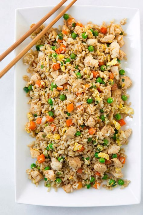 This Chicken Fried Rice is the perfect weeknight dinner! Better than take-out and made with healthy ingredients like brown rice, vegetables and lean chicken breasts. It's super easy to make and perfectly delicious! Plus it's something everyone can agree on including picky eaters. #chicken #friedrice #chinese #recipe #dinner