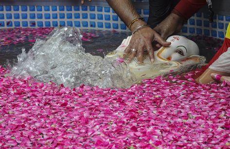 A devotee immerses an idol of Hindu God Ganesha in an artificially created pond  to go eco friendly at Juhu in Mumbai.  #everydaymumbai  #phodus #phodus_competition  #creativeimagemagazine #lensculturetalent #lensculture #1000kata  #reportagespotlight #photojournalism #ganeshvisarjan  #ganesh #ganeshotsav #festival #gettyimages #culture #mumbai_uncensored  #mumbai_igers %