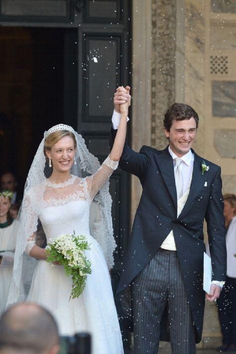 5/7/2014: Prince Amedeo of Belgium and bride Elisabetta Rosboch von Wolkenstein celebrate as they leave the basilica Santa Maria in Trastevere in Rome.