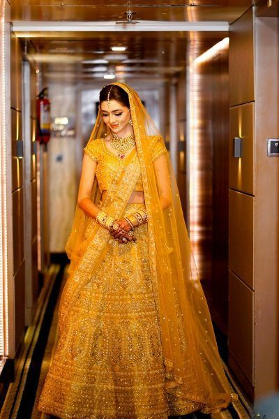 A Minimalist Mumbai Wedding With A Bride In A Self-Designed Breathtaking Gold Lehenga!