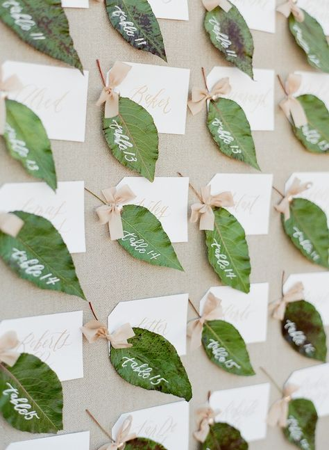 Pretty Pear & Leaf Escort Cards & Table Number Ideas from Amy Osaba Design ~ leaves are written on in white with blush bow and attached to white escort card