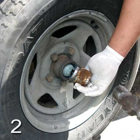 Photo of removing the dust cover or Bearing Buddy with a
