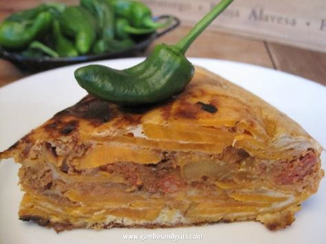 The Spanish version of sweet potato pie, or the Southern version of the typical tortilla española. Either way, a delicious combination of spicy and sweet that is great for a potluck or as a Plan B for dinner.      Spanish Tortilla with Yams & Chorizo | Gambas and Grits: A Texas Foodie Deep in the Heart of Spain