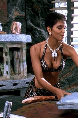 Halle Berry as Miss Flintstone in The Flintstones