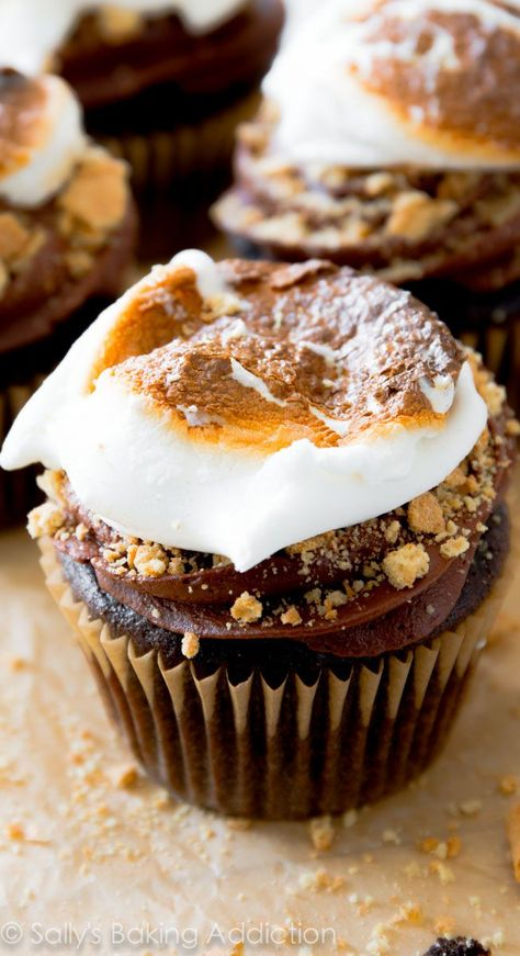 Moist and light chocolate cupcakes stuffed with a creamy marshmallow filling, topped with milk chocolate frosting, crushed graham crackers and a toasted marshmallow. S'mores have never tasted so good!