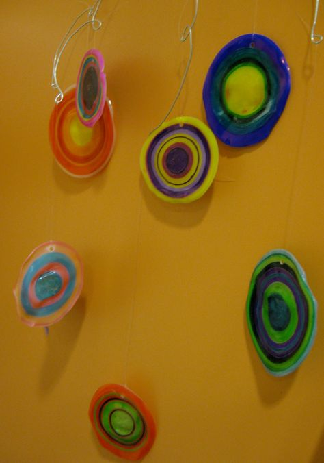 Kandinsky-inspired mobile: paint clear plastic cups with sharpies then bake . . . seriously? HOW cool??!