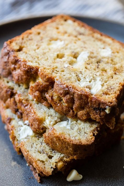 We've only given you 50 Banana Bread recipes, so why not make it 51 with this moist white chocolate banana bread full of white chocolate chips and banana flavor! #bananabread #whitechocolate #whitechocolatechips #bread #quickbread #recipe #breadrecipe #bananas #easyrecipe #quickrecipe #familyrecipe #kidfriends #familyfood