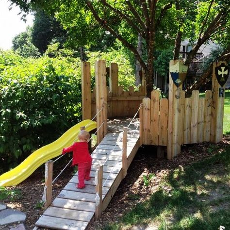 The {DIY Play Castle} that puts ordinary tree houses to shame! I love how it wraps around a tree and uses the slope.
