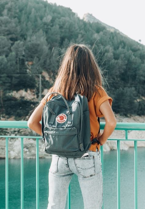 Mountains kanken backpack adventure girl lake In Fjällräven, a company based in Sweden, launched the rectangular two strap alternative to the common over-the-shoulder school bags.