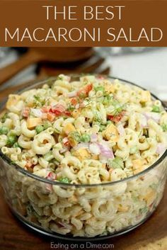 This Easy Macaroni Salad recipe is the perfect side dish to bring to Summer BBQ's, parties and more! Easy macaroni salad is loaded with veggies, cheese and more. You will love the creamy dressing in Macaroni salad recipe. Try this Pasta salad with mayo. Everyone will love this simple Elbow macaroni salad! #eatingonadime #macaronisalad #partyfood #potluckfood #bbqfood