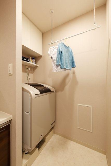 価格 Com 室内で物干しできるように 洗面所のリフォーム事例