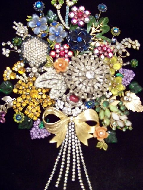 rhinestone and junk jewelry bouquet to be framed. -Awesome idea!