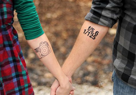 Photography geeks couples tattoos.