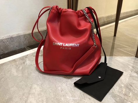 Purchase a Saint Laurent Teddy Drawstring Bag in Red Smooth Leather at cheap  rate- USD 403. Free Global Shipping by courier. 05efea6a289ff