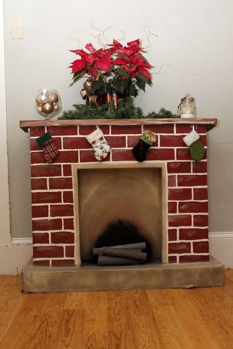 100 current and traditional ideas for your Christmas fireplace - Fresh ideas for the interior, decoration and landscape - red bricks christmas fireplace christmas decoration - Wooden Fireplace, Cardboard Fireplace, Fake Fireplace, Wooden Mantel, Fireplace Mantels, Fireplace Ideas, Fireplace Decorations, Fireplaces, Diy Christmas Decorations
