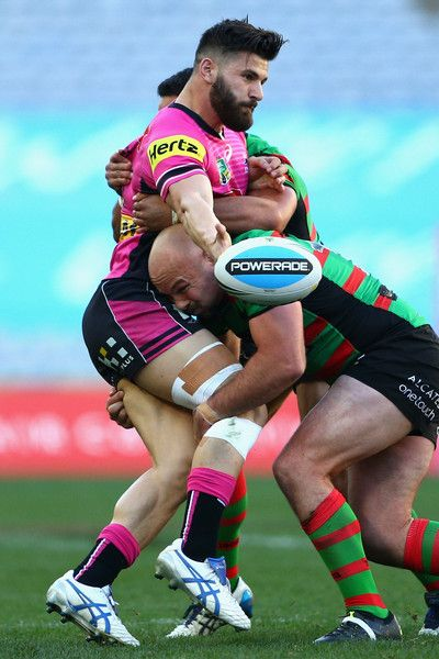 Josh Mansour of the Panthers offloads the ball in a tackle during the round 21 NRL match between the South Sydney Rabbitohs and the Penrith Panthers at ANZ Stadium on August 2015 in Sydney, Australia. - NRL Rd 21 - Rabbitohs v Panthers