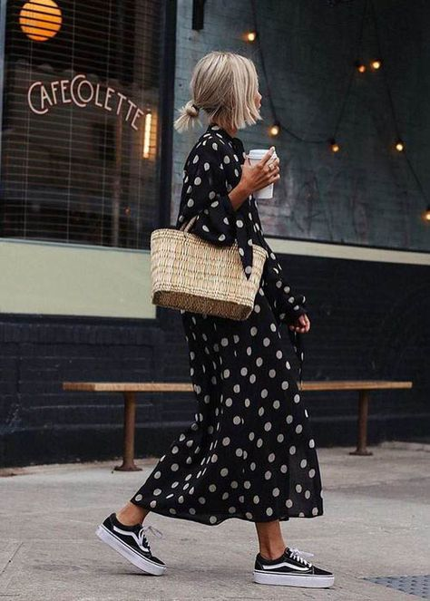 Simple blonde bun hair style, polka dot monochrome maxi dress, wicker basket, old stool vans, spring street style, minimal street style outfit, maxi dress outfit inspo