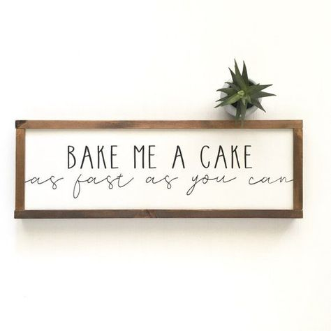 Bake Me A Cake Sign ********************************************************************** SIGN DETAILS DIMENSIONS: Select Variant FONT COLOR: Black BACKGROUND: White FRAME: Dark Wood Each sign is made from 1/4 plywood with a smooth finish. Frames are all sanded, routed,