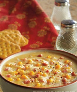 Crockpot Corn Chowder: Place 4 potatoes (peeled and diced), 1 can of cream corn, 1 can of whole kernel corn, 2 c. of chicken broth, 8 oz. of diced ham,