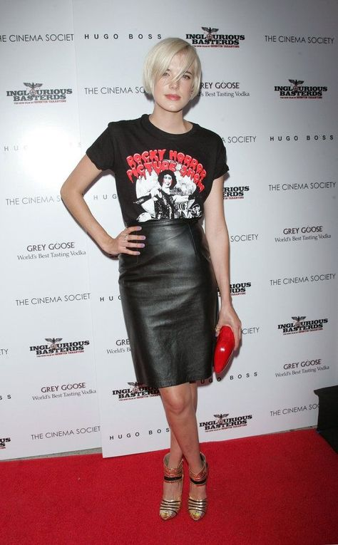 The Brit model donned a rock-chic look — vintage tee, black leather skirt, and superfly gold kicks — at a party in NYC. Add this leather Jason Wu