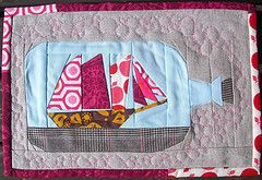 Amazing ship in a bottle mini quilt.