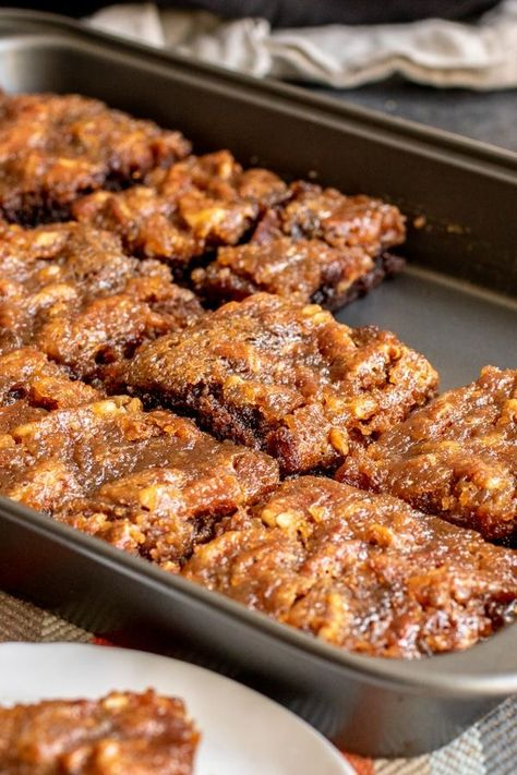 Pecan Pie Brownies are an amazing Thanksgiving dessert recipe that combines two classics, rich, fudgy chocolate brownies, and pecan pie, into one awesome dessert. Pecan pie filling is baked on top of brownies for a sweet, fall dessert that will become your favorite Thanksgiving recipe! #thanksgiving #thanksgivingdessert #pecanpie #brownies #thanksgivingrecipe #homemadeinterest