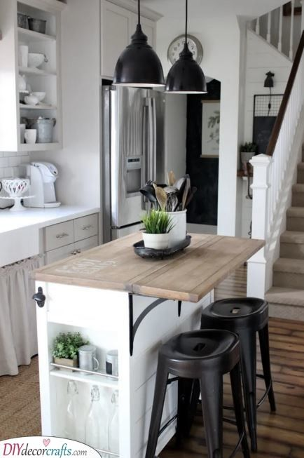 A Kitchen Counter With Flip Up Table Portable Kitchen Island Kitchen Island With Seating Modern Kitchen Island