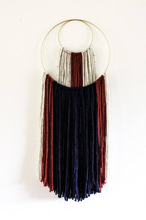Handmade wall hanging, made of both acrylic and wool yarns. Hung from a 14 diameter silver metal hoop, with a 6 diameter hoop detail. We apologize, but there are no refunds.