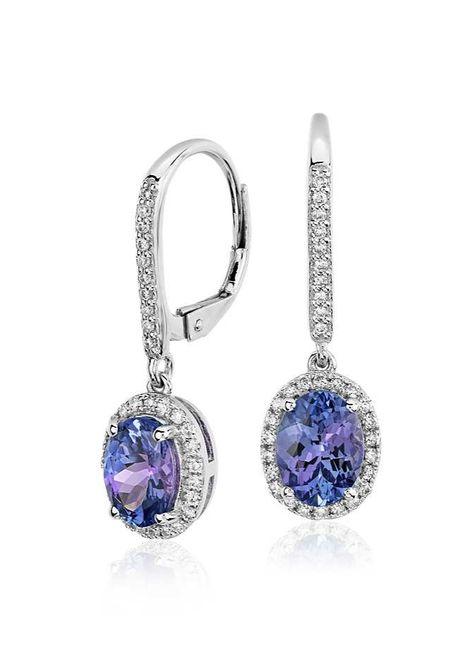 Delicate in design, these earrings showcase vibrant oval tanzanite gemstones surrounded by sparkling micropavé diamonds framed in 14k white gold.