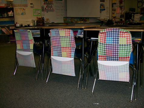 Genius!  Use stretchable book covers as chair pockets.  You can stock up during back-to-school sales!