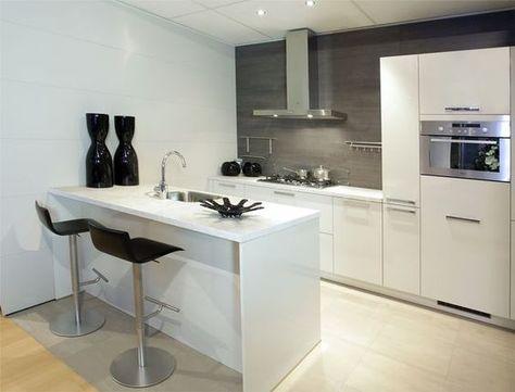 Een keukenbar is een mooie toevoeging aan je keuken. bekijk de 15
