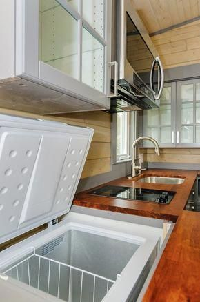 Deep Freeze In Counter So Cool 300 Sq Ft Custom Tiny Home On Wheels By Wishbone Tiny Homes 0015 Tiny House Furniture Modern Tiny House Tiny House Kitchen